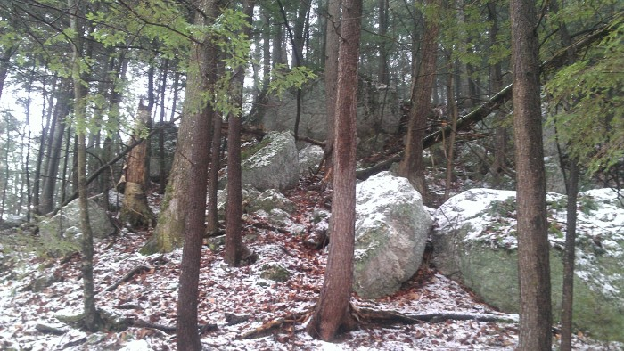 The ledges and boulders to the left of the notch.