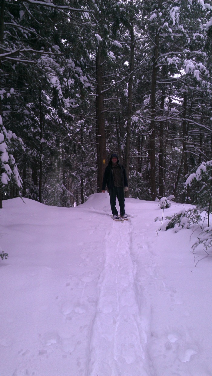 Andrew hiking in the snowshoe path.