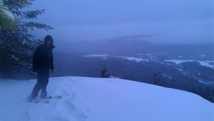 Andrew on the summit of Mount Crag.  Shelburne and the Androscoggin River can be seen below.
