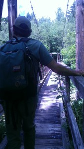 Andrew hesitates before going out on the suspension bridge.