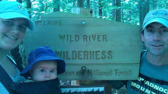 Family photo at the Wilderness sign.