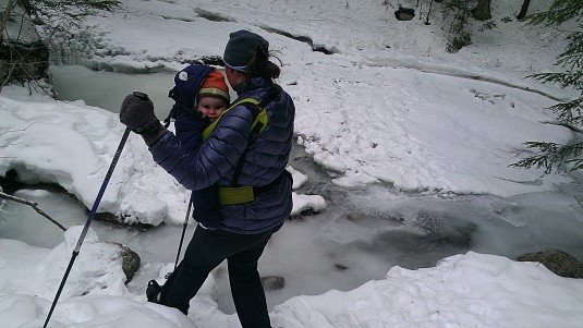 Lindsay and Alden step down toward a stream crossing.
