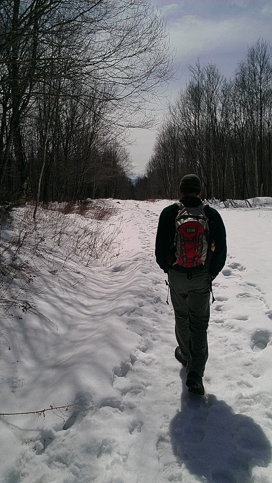 Andrew walks down the trail.