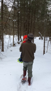 After the snowshoes proved too difficult for Alden, Andrew walked him into the woods.