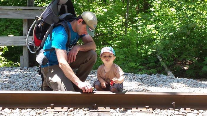 Playing trains on the train tracks.