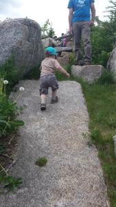 Climbing back up the natural rock slide.